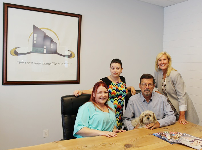 MCRS Property Management staff (from left) Kirsten Dale, Stephanie Piercey, Don Klowak (with Spike) and Debbie Dale treat their clients' homes like they are their own.