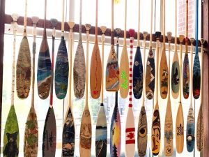 You can get a jump start on Culture Days activities - some of the paddles submitted to the Algonquin Outfitters paddle art contest are hanging on the second floor of the Civic Centre (Photo: Teri Souter)
