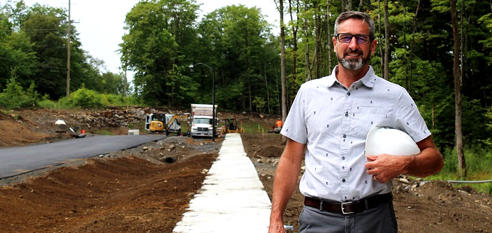 Greystone owner and president, Pat Dubé, at the new entrance road to Campus Trails and the future Fairvern site