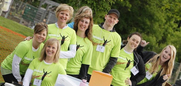 You'll see many smiling volunteers at the annual Band on the Run road race (Photo: Volunteer Muskoka)