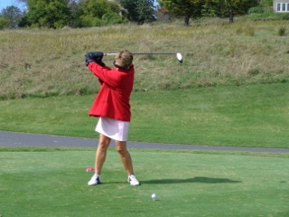 """Chartwell's """"Golfing Through the Eyes of a Senior"""" hole required participants to tee off with a heavy jacket, thick gloves and vision-impairing glasses"""