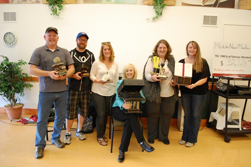 2015 Muskoka Novel Marathon winners from left: Dale Long (spirit award), Colum McKnight (rookie award), Dawn Huddlestone ('tekkie' award), Cheryl Cooper (Remy award), Lenore Butcher (most prolific, bum-in-chair, and young adult manuscript winner), Donna Curtin (adult manuscript winner)