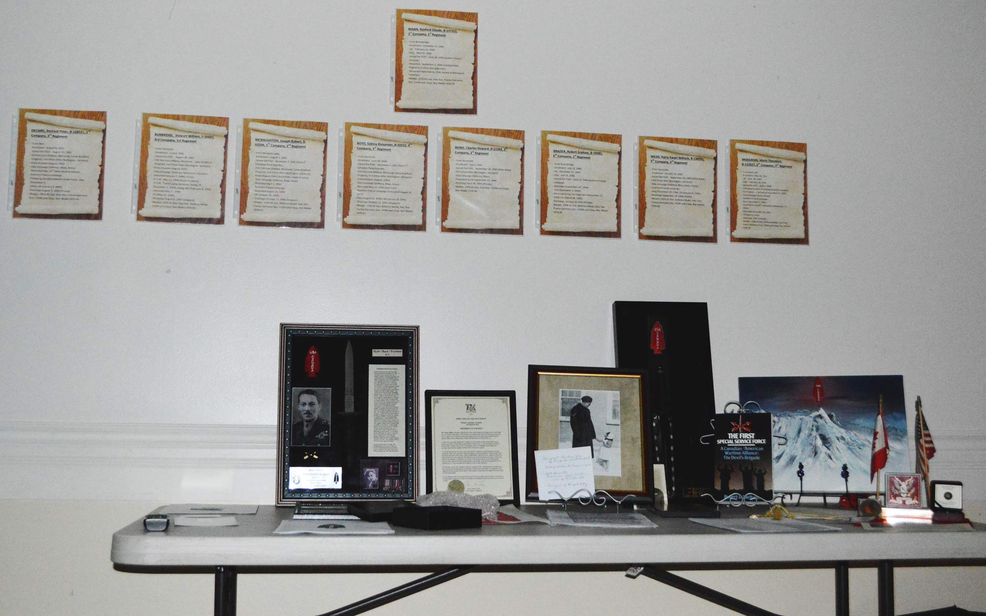 A display of World War II memorabilia brings the past into focus. Above are the names of local men who were apart of the First Special Service Force, a group of highly trained soldiers