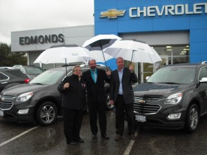(From left to right) Wendy McConnell, Ward Edmonds, Richard Janssen pose with the vehicles one week before the beginning of the tournament
