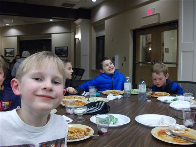 Young fans and hockey players enjoying their dinner before the Otters took to the ice against Midland