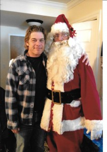 Never too old to put your arm around Santa (with Grant Nickalls)