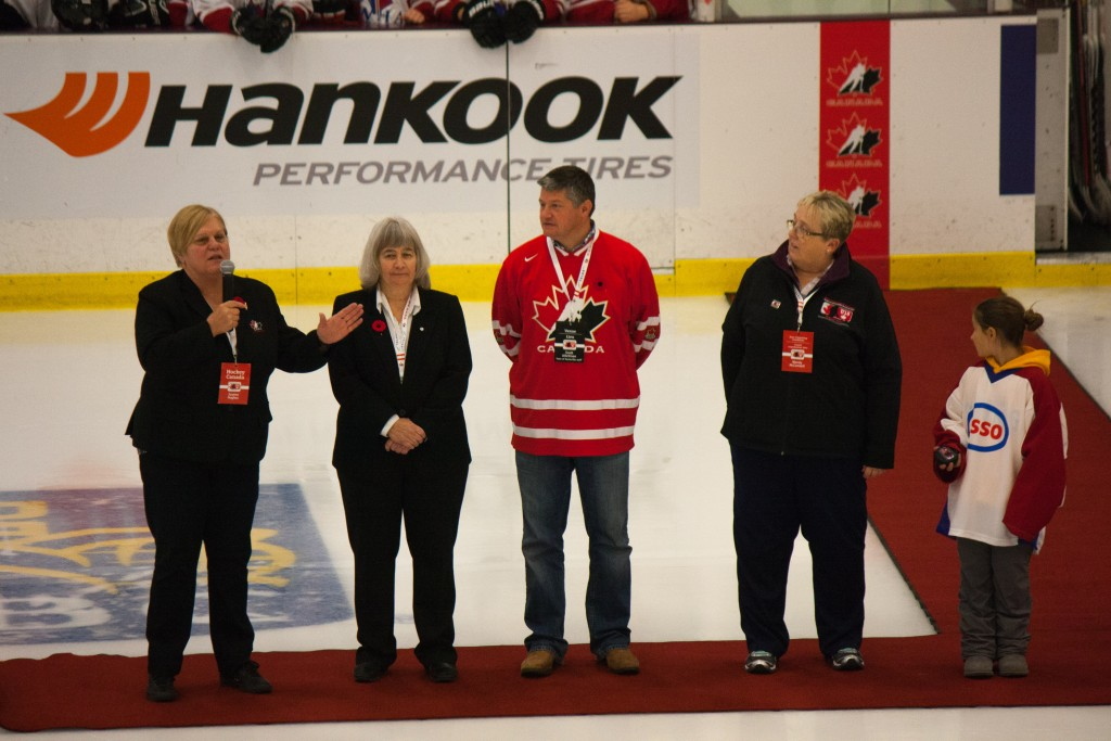 (From left to right): Joanne Hughes, Chair of Female Council at Hockey Canada, addresses the crowd alongside Ontario Women's Hockey Association President and Ceo Fran Rider, Huntsville Mayor Scott Aitchison, and Host Committee Chair Wendy McConnell