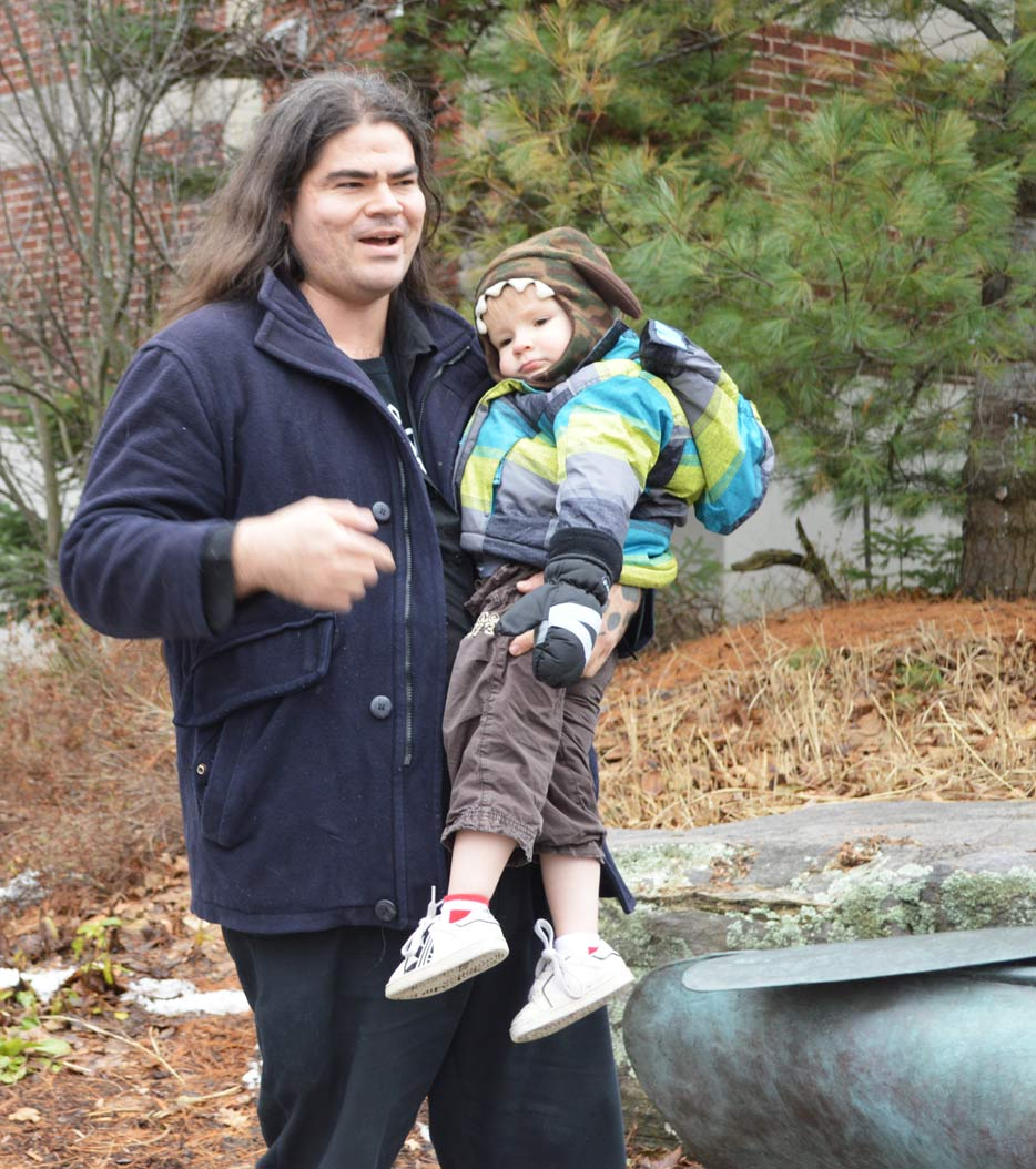 Muskoka Cash Mob organizer John Sailors, with son Mahikan, gave a special thanks to the group that came out to support local shopping.