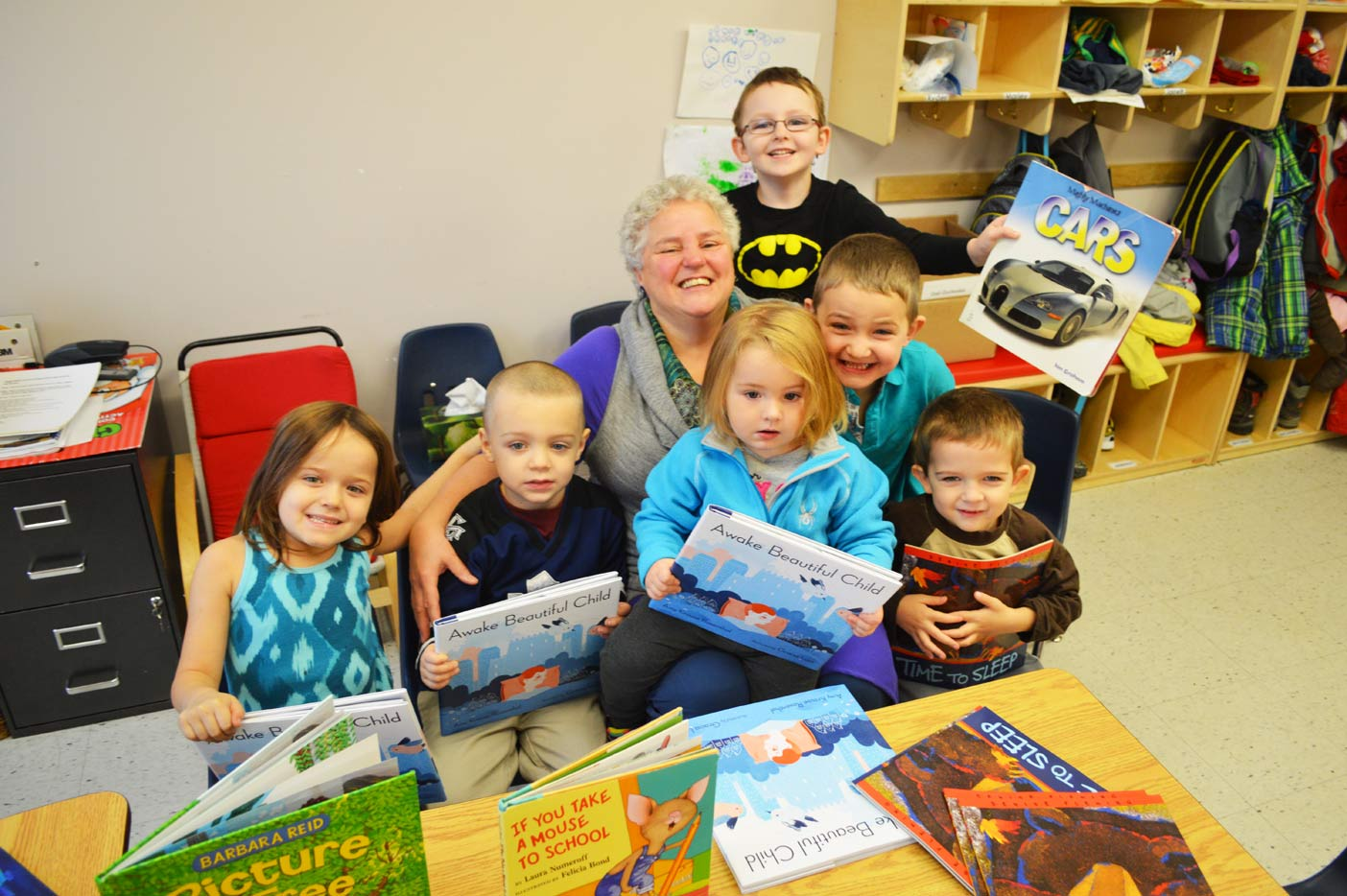 The kids at a local Montessori School are always happy to see Sandy Inkster, especially when she comes to read. They each received a free book from Inkster on Tuesday.