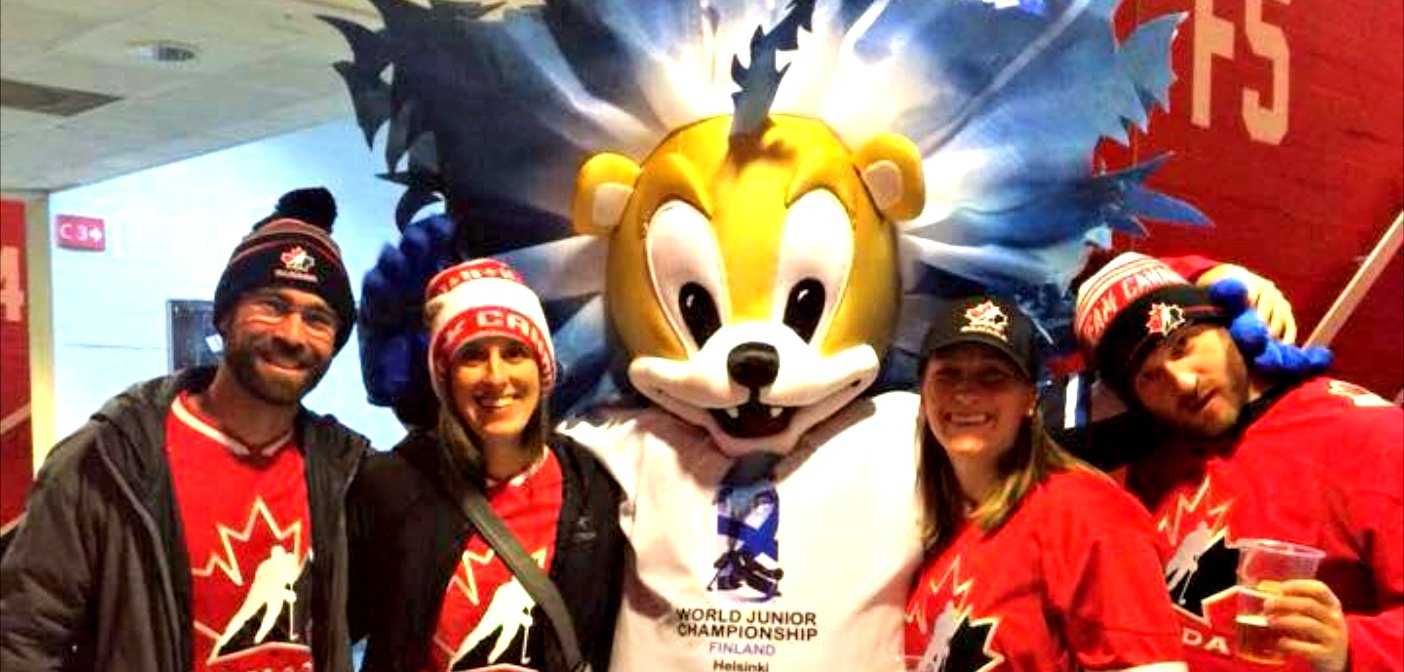 From left, Chris Near, Rebecca Francis, Kristin Adams and Phil Adams with the World Juniors mascot in Helsinki