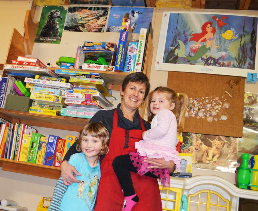 Jane with Julia (left) and Lucy, two of the kids she spends a lot of time with who attend her at-home daycare.
