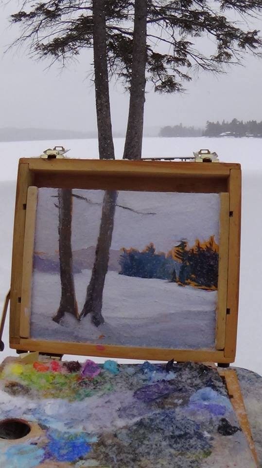 While painting Two at Two, at Lake of Two Rivers in Algonquin Park, Marson had to contend with the cold and snowflakes landing on her palette and her painting. Photo courtesy Janine Marson.