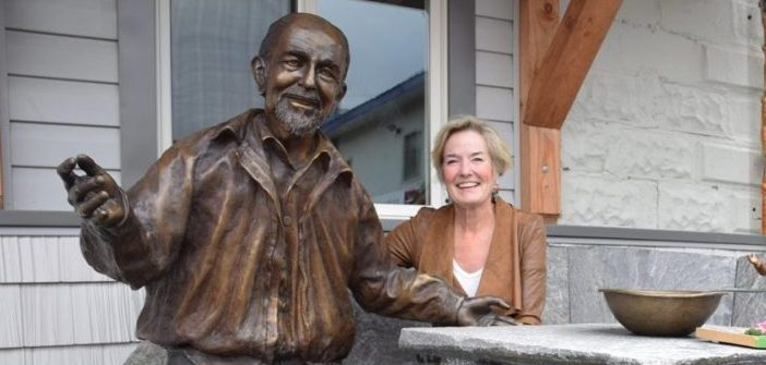 Artist Brenda Wainman Goulet, the creator of the affable George, sits by his side on a beautiful stone table and bench created by the talented Rudi Stade outside of Huntsville's men's shelter in 2016