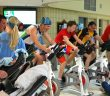 The final wave of the inaugural indoor tri pumps through the bike heat