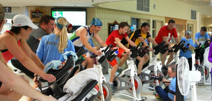 The final wave of the indoor tri pumps through the bike heat