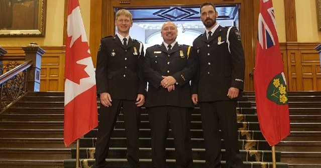 Paramedics Mark Verbeek and Neil Hebb with Chief Jeff McWilliam