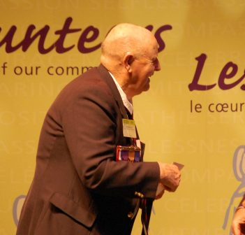 Ray Townsend receives an award from MPP Norm Miller for more than 55 years of volunteer service