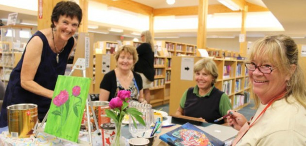 Nancy Alcock, Karen Cassian, Karin Terziano and Diane Thoms are all smiles while working on their masterpieces.