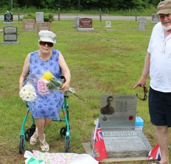 Victoria Bradford and William Bradford tend to some family graves at the Madill Cemetery
