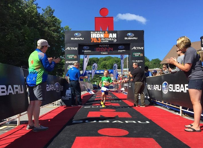 At the finish line - shown here for the IronKIDS triathlon - volunteers offer congratulations, water and support (Photo: Rich Treholm)