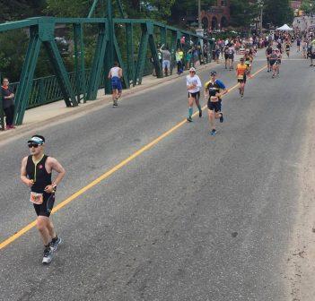 Ironman 70.3 runners cross the swing bridge in 2017 (Photo: Rich Trenholm)