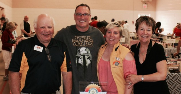 Nick Paroschy, Steve Lavigne, Suzanne Willett and Lynn Doyle from the Rotary Club of Huntsville Lake of Bays are all smiles at the book sale.