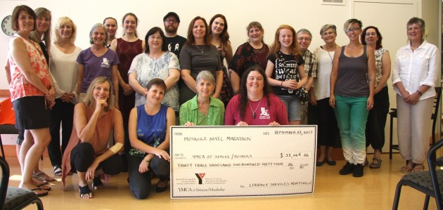 Some of the writers and volunteers for the 2017 Muskoka Novel Marathon present a cheque to YMCA Simcoe/Muskoka for literacy programs in Huntsville