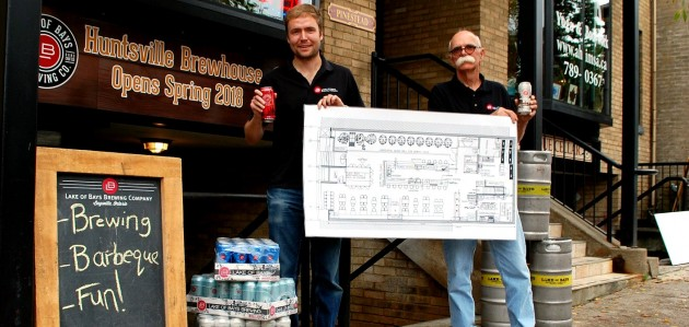 Lake of Bays Brewing Company president Darren Smith and brewmaster Dan Unkerskov with plans for the Huntsville Brewhouse on Main Street