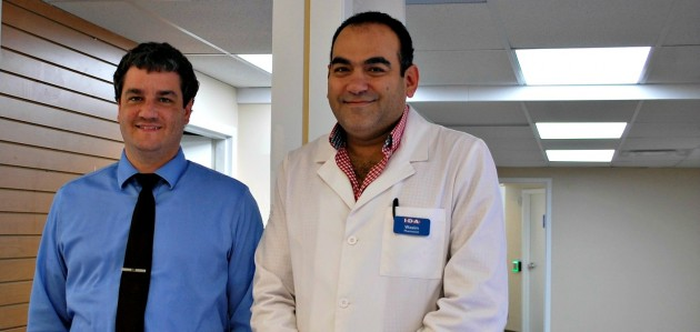Dr. Richard Brûlé (left) and Hometown IDA pharmacist Wasim Daoud in front of the new Hometown Clinic