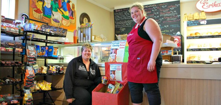 Tanya (left)and Erika Grainger with the cottage closing food drive donation bin at Erika's in Dwight