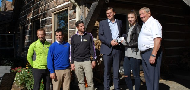 (From left) Roger Penney, Ryan Barry, Andrew Nieder, and Luke Nixon-Janssen of Deerhurst Resort present a cheque to skier Dara Howell and Gord Durnan of the Muskoka Community Foundation