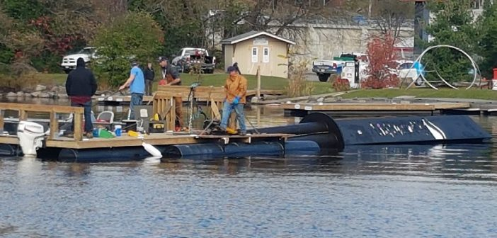 A Pipefusion crew works to remove Pipe Man from the Muskoka River on October 26