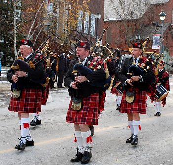The Cameron of Lochiel Pipes and Drums Band participates in the annual Remembrance Day ceremony and parade