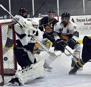 The Otters get the puck past the Hawks' goaltender on their way to a 3-2 win