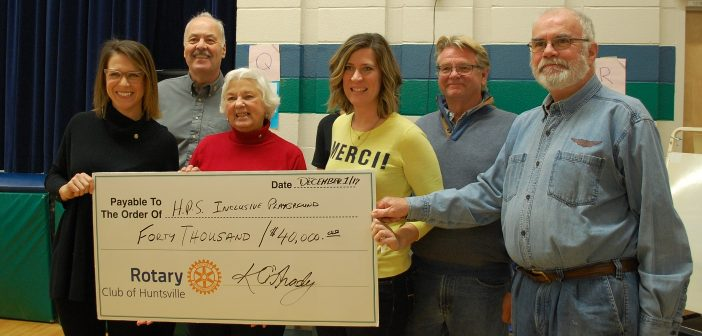 HPS teacher Kerri-Lynne Knappett (third from right) accepts a cheque from Rotarians (from left) Kim O'Grady, Lea Barker, Barbara White, Jamie Thompson and Ross Kirwin