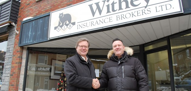 Tim Withey (left) and Sean McIlroy in front of the former McIlroy Insurance Brokers office on Main Street