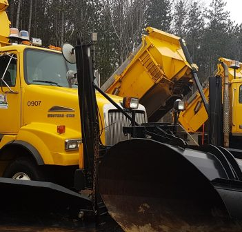Some of the Town of Huntsville's combination plow/sanders were ready to go and awaiting snow early in December