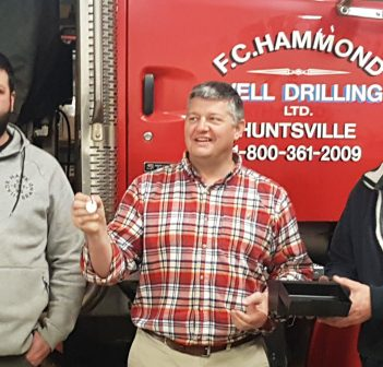 Mayor Scott Aitchison draws the lucky winner with Kyle Cunnington (left) and Jeff Yearley