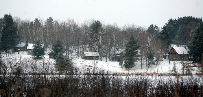 Muskoka Heritage Place's pioneer village as viewed from across Cann Lake