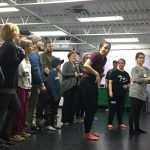 "Kasey Stephan-Charlebois leads some of the Oliver! cast through choreography of ""Consider Yourself"""