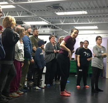 """Kasey Stephan-Charlebois leads some of the Oliver! cast through choreography of """"Consider Yourself"""""""