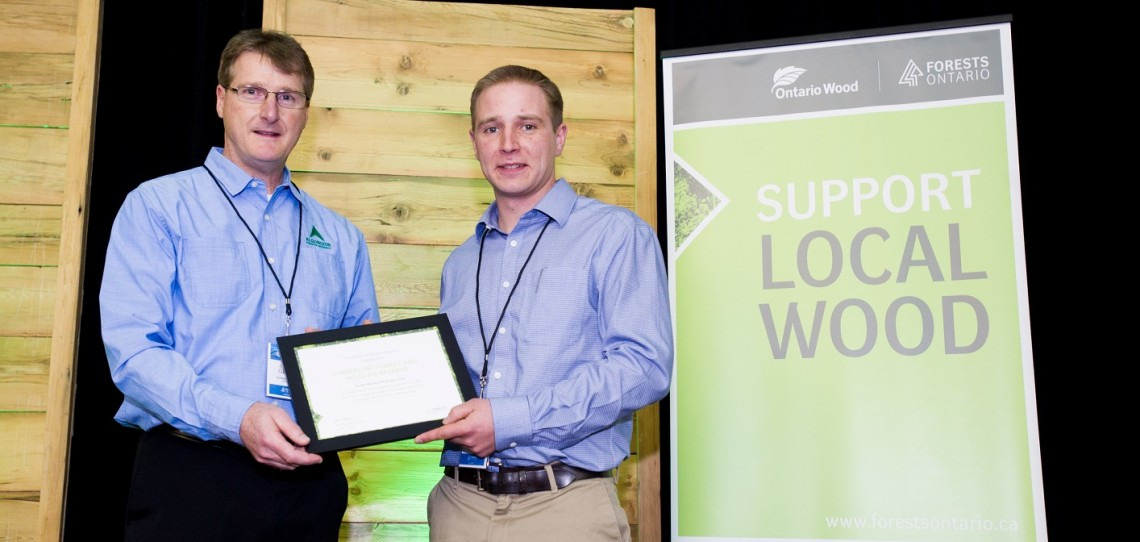 Gareth Cockwell (right) receives the award on behalf of Limberlost Forest and Wildlife Reserve from Gord Cummings, Chief Forester at Algonquin Forestry Authority (Photo courtesy of Forests Ontario)