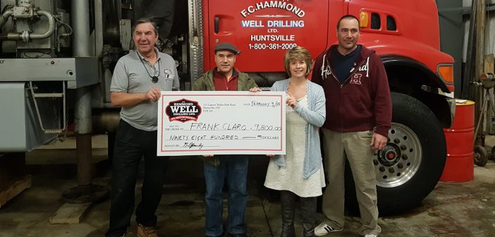 (From left) F.C. Hammond Well Drilling co-owner Norm Yearley, well draw winner Frank Claro, Hospice Huntsville's Melissa Polischuk and F.C. Hammond Well Drilling co-owner Jeff Yearley