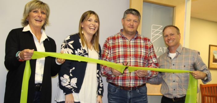 Stephanie Bourbeau is joined by her parents Annie Cotnoir and Real Bourbeau as Mayor Scott Aitchison welcomes the new business, Elevate Physiotherapy.