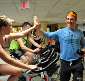 Rich Trenholm encourages the participants in the bike portion of the TriMuskoka Winter Indoor Triathlon in March 2018