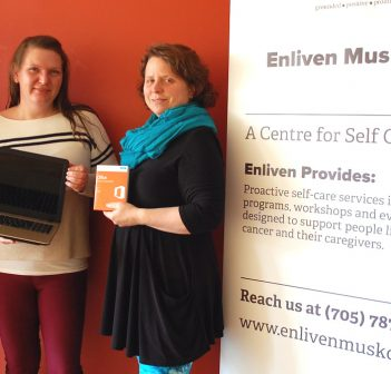 (From left) Jim Brendish of Brendish Computers presents a new laptop to Catherine Prosser and Allie Chisholm-Smith of Enliven