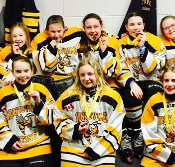 The Huntsville PeeWee Sting Yellow show off their bronze medals at the 37th annual Walter Gretzky Girls Hockey Tournament