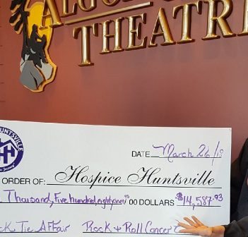 Jamie Clark (left) and Mike Shaver present the proceeds from the second annual Rock and Roll Black Tie Affair to Melissa Polischuk (right) from Hospice Huntsville (supplied)