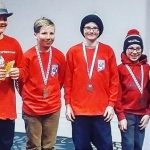 Justin Caswell (centre) brought home gold from Timmins on Easter weekend (supplied photo)