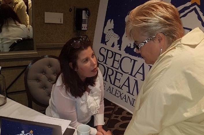 Anne Larcade tells a 2017 WITHorg summit attendee about her charity Special Needs Dreamworks (supplied photo)